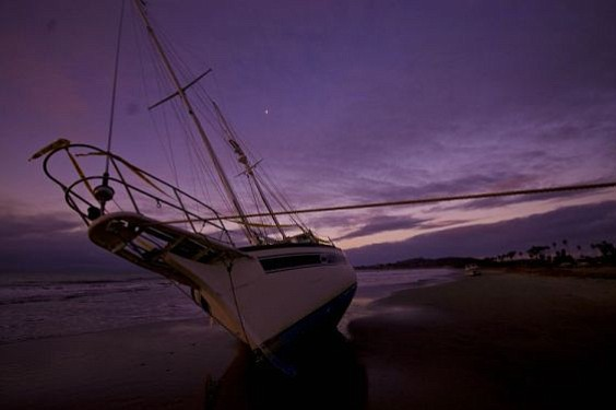 The most recently washed-up sailboat in a string of five.