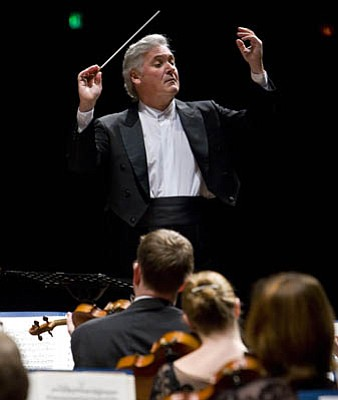 Pinchas Zukerman was as comfortable wielding a baton as he was with his violin when he appeared with the Royal Philharmonic at the Arlington.
