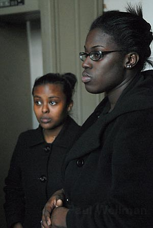 Aseye Allah (left) and Meron Meshesha listen Thursday to jury foreperson Drew Wakefield (not pictured) explain the reasons behind the jury's decision to convict Allah on misdemeanor charges of obstructing a peace officer.