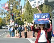 Maria Papacostaki (foreground) and a crowd of 20 gathered at noon on Moday at the corner of State and Carrillo promoting Hillary Clinton in advance of Super Tuesday.