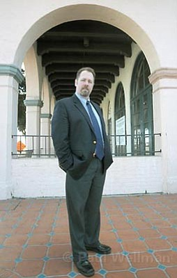 Casa Esperanza Executive Director Mike Foley poses in front of the shuttered Californian Hotel. 