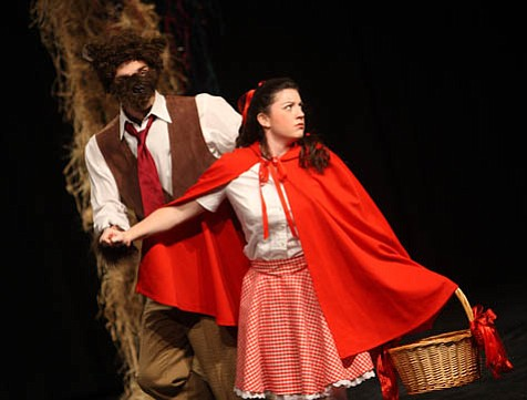 Red Riding Hood (Christina Farris) and the Wolf (Matt Kissel) are just two of the many familiar characters from fairy tales who inhabit Sondheim's <em>Woods</em>.
