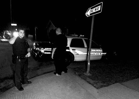 Cops respond to the February 15 stabbing.