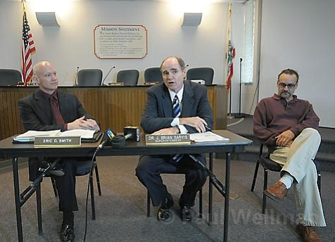 Superintendent Brian Sarvis (right) and interim budget guru Eric Smith deliver some bad budget news at district headquarters Tuesday afternoon.