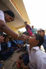 Vitamins are distributed in a fishermen's village outside of Vasai, India.