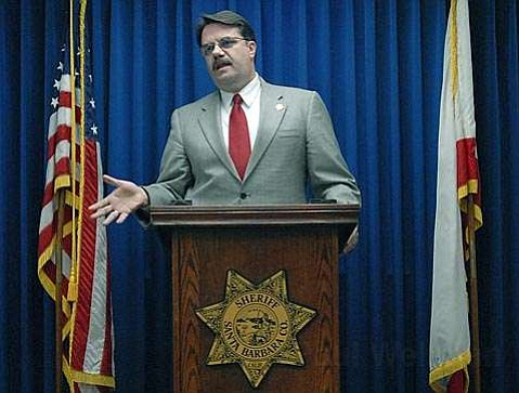 Sheriff Bill Brown addresses the press