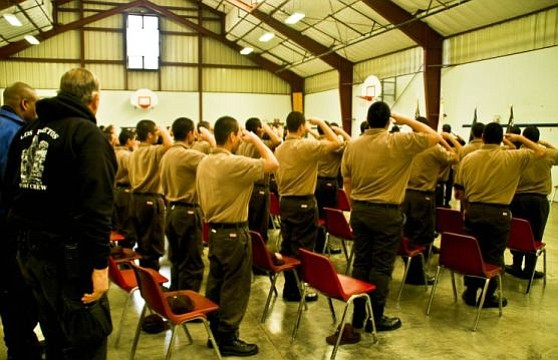 Youth at the Los Prietos Boys Camp salute for the National Anthem.