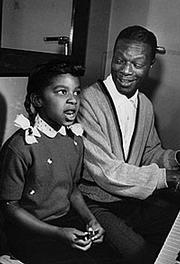 Natalie Cole with her father, Nat King Cole, ca. 1960.