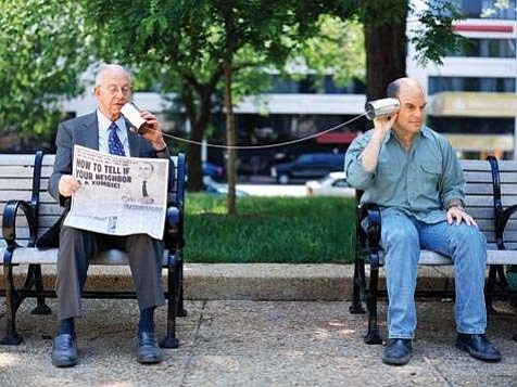 """Peter Sagal (right)-host of NPR's<em>Wait Wait : Don't Tell Me!</em>-always has his ear to the news,  no matter how silly the news may be. Speaking into the """"mike"""" is Carl Kasell, veteran announcer (quiz prize is his voice on your answering machine)."""