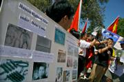 Chinese protesters accuse Tibetans of violence in Lhasa.