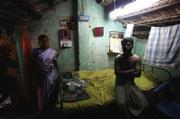 In a slum on the outskirts of Chennai, India's fourth largest city and a hub of automakers and high-tech businesses, this family of five sleeps together in this small room, one block from the smolderÂ-ing trash dump. This father can make close to $2.50 a day at a sawmill-considerably higher than the typical dollar-a-day wage for laborers-but there are only 10 days of work per month.