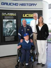 The UCSB Gauchos' #1 fan Phil Womble, who's in his 70s despite being born with cerebral palsy, is joined by, from left, UCSB sports information director Bill Mahoney, athletic director Gary Cunningham, and associate athletic director Diane O'Brien.