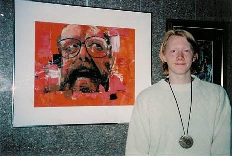 "An adolescent Jacob stands next to his award-winning portrait of his art teacher, ""Orange Man"".courtesy"