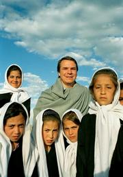 Greg Mortenson with students in Central Asia