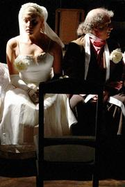 Kate Paulsen and Stanley Hoffmann look the part in Lit Moon's production of <em>The Wedding</em>.