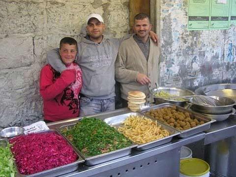 Falafel sellers on East Jerusalem sidewalk.