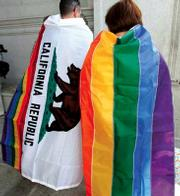 Gay rights supporters wear the California state flag and a gay pride flag outside of the state's Supreme Court  building in San Francisco last Thursday after the court's ruling was announced.