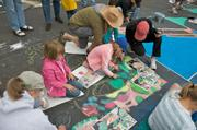 Roosevelt 2nd graders carefully lay out their designs and begin to work a small part of the overall painting.