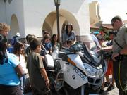 Ellwood School students check out a police motorcycle at the new Goleta police station.