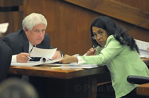 SHOW ME THE MONEY:  County CEO Mike Brown consults with budget specialist Zandra Cholmondeley on the county's fiscal situation. The county is facing $15 million in cuts, with a potential $8.4 million more in the ADMHS department.