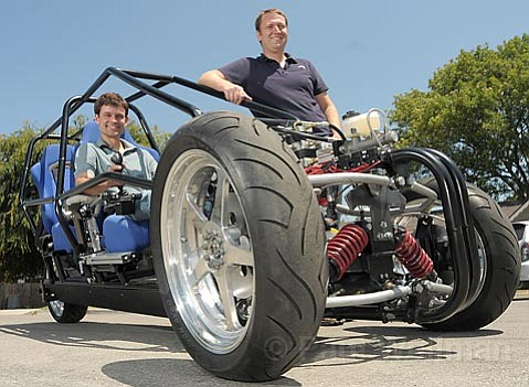 Multimode Technologies President/CEO Ben Werner (left) and Chief Engineer Eric Sandoz show off an inner view of their three-wheeled electric hybrid, Dagne.