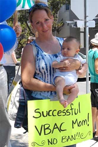 Protestor Jennifer Vanschmus and her child, Devin.