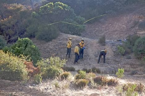 County Fire Investigators look for evidence near the point where the Gap Fire began Tuesday evening. Fire started on the left, just outside the photo.