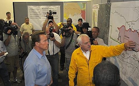 Santa Barbara County Fire Chief John Scherrei briefs Governor Arnold Schwarzenegger on the Gap fire