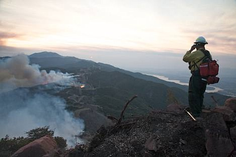 Spotter looks down on backfiring operations on the saddle at the top of Winchester Canyon.
