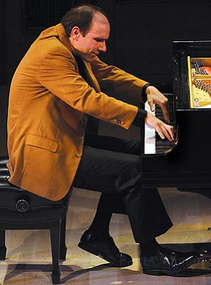 Pianist Christopher Taylor explored the limits of musical endurance with his two-and-a-half hour solo performance of Olivier Messiaen's <em>Vingt regards</em>.
