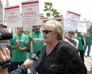 Donna Carpenter, vice chancellor for administrative services, speaks with the media during the strike on July 14.