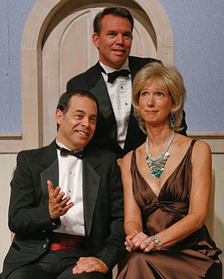 In Rumors, Raymond Wallenthin as Ken Gorman (standing) and Dan Gunther and Nancy Nufer as Lenny and Claire Ganz (seated) are caught in a web of hysterically funny lies.