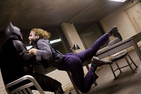 Heath Ledger as Joker and Christian Bale as a gruff-voiced Batman in <em>The Dark Knight</em>.