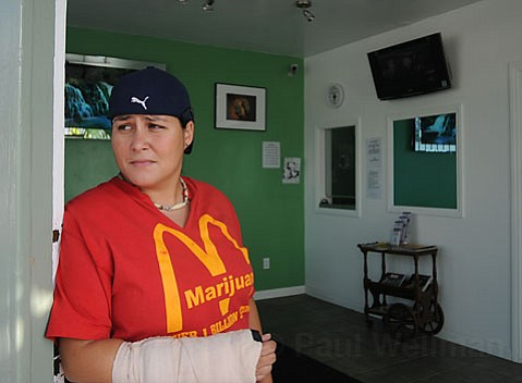 Mc-What? An employee at the Healing Center, a medical marijuana dispensary on S.B.'s Westside, stands in the doorway of the club on Tuesday evening. Despite being served with a shut-down injunction late last week, the San Andres storefront remained open.