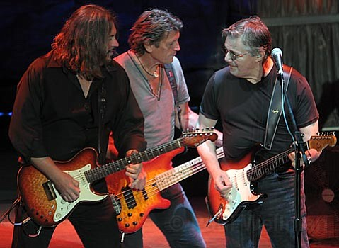 Steve Miller (right) rocks out with fellow band mates Billy Peterson (left) and Gordy Knudtson (center) during Thursday night's Bowl show.