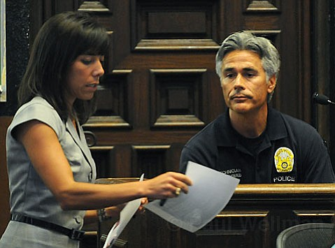 Examination:  Santa Barbara police crime-scene investigator Mike Schwab checks out a photo of evidence gathered following the March 14, 2007, stabbing of Luis Linares. Defense co-counsel Jennifer Archer (left) is trying to prove 15-year-old Ricardo Juarez didn't kill Linares.