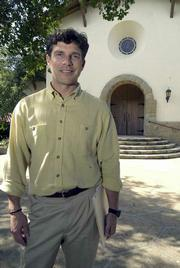 On his first day of work as La Casa de Maria's executive director, Jim Villanueva (pictured in 2002) discovered the organization was in default on its mortgage