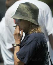 Elvy Musikka takes a smoke break