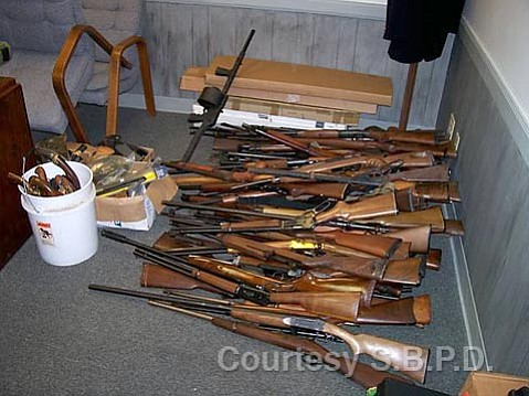 CONFISCATED: Among the seized guns considered to be illegal were a TEC-22, a TEC-9, a MAC-90, a Ruger Mini-14, an SAS-12, and a TEC-DC9, among others. Weapons taken in the August 7 incident included rifles, handguns, swords, grenades, bows, arrows, and several hundred pounds of ammunition.