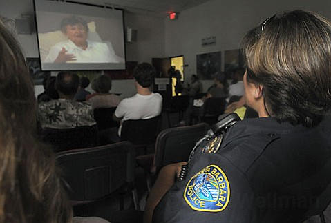 Police officers, along with gang members, have been participating in the Portraits of Survival program to help foster communication and understanding.