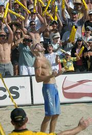Phil Dalhausser and crowd celebrate after the match point.