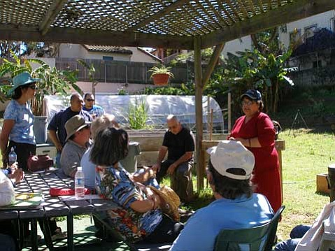 Master Gardener trainees from the 2007-2008 class at Arroyo Gardens listen to a presentation from Margaret Trejo, director of Resident Services for the Housing Authority City of Santa Barbara.