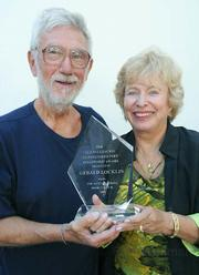 Gerrald Locklin (left) presented with the Glenna Luschei Distinguished Poet Fellowship Award at Santa Barbara's Book & Author Festival. Glenna Luschei is pictured right.