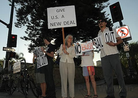 """A small group on the corner of Carrillo and Chapala streets protest: """"No Bush Bailout"""""""