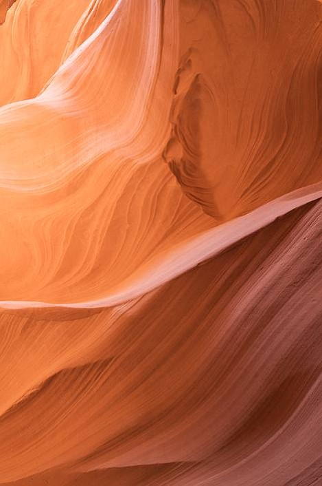 Lower Antelope Canyon near Page, Arizona provides a slice of spectacular beauty carved out by the forces of water cutting through soft Navaho Sandstone.