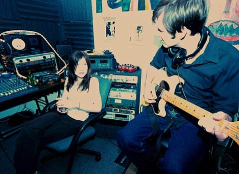 The Spires' Colleen Coffey and Jason Bays hard at work in the band's Ventura studio.