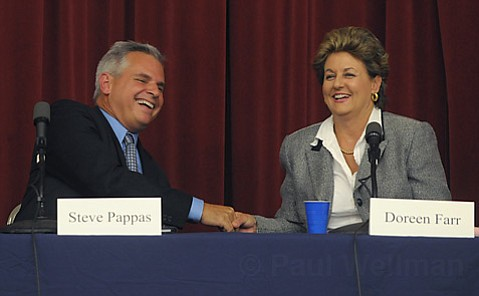 Steve Pappas and Doreen Farr end the debate with a handshake