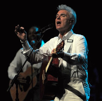 Former Talking Heads frontman David Byrne led an ecstatic crowd through a night of song, dance, and new wave worship during Saturday's performance at the Arlington.