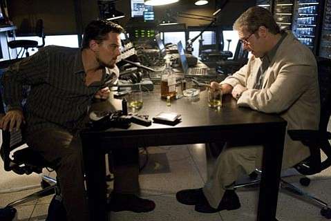 Leonardo DiCaprio (left) stars as a CIA agent doing work in the Middle East in <em>Body of Lies</em>.