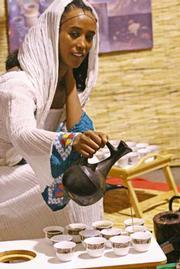 Sabe Tewolde serves Ethiopian food at the World Fest.